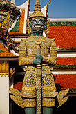 temple roof stock photography | Thailand, Bangkok, Statue of a yaksha (demon), Wat Pra Keo, image id 4-194-34