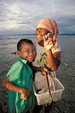 two people stock photography | Thailand, Phuket, Children collecting mussels, Nai Yang Beach, image id 7-523-34