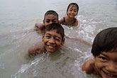 horizontal stock photography | Thailand, Phuket, Children swimming, Nai Yang, image id 7-528-3