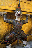 painted face stock photography | Thailand, Bangkok, Guard holding Golden Chedi, Wat Pra Keo, image id S3-101-9