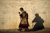 woman walking stock photography | Tibet, Pilgrim circumambulation, Labrang Monastery, Xiahe, image id 4-125-30