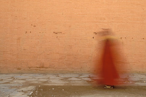 4-130-21  stock photo of Tibet, Monk circumambulating Labrang Monastery, Xiahe