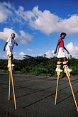 two people stock photography | Tobago, Children practising stilt-walking for Carnival, image id 8-62-26