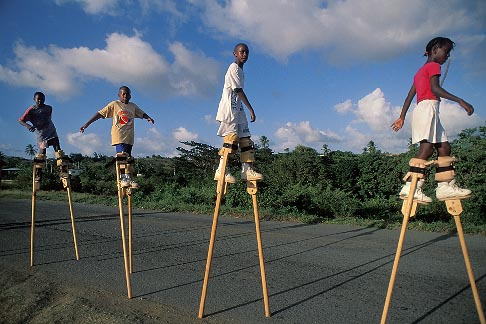 8-62-28  stock photo of Tobago, Children practising stilt walking for Carnival