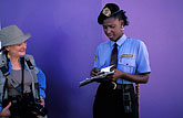 crime fighter stock photography | Trinidad, Port of Spain, Policewoman giving ticket, image id 8-11-20