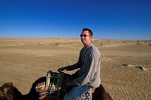 image 3-1100-14 Tunisia, Nefta, Riding a camel