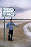 direction signs stock photography | Tunisia, Hitchhiking in the desert, image id 3-1100-18