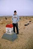 one man only stock photography | Tunisia, Milestone in the desert, image id 3-1100-43