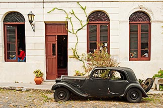8-802-4318  stock photo of Uruguay, Colonia del Sacramento, Abandoned antique automobile on cobbled street