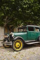 vertical stock photography | Uruguay, Colonia del Sacramento, Abandoned antique automobile on cobbled street, image id 8-802-4381