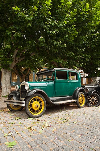 image 8-802-4382 Uruguay, Colonia del Sacramento, Green antique automobile parked under tree