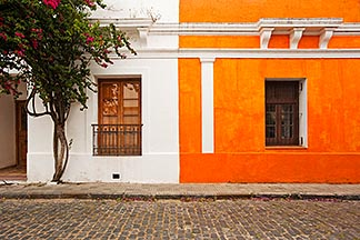 8-802-4425  stock photo of Uruguay, Colonia del Sacramento, Orange and white painted historic facades