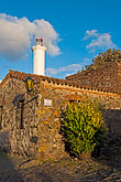 vertical stock photography | Uruguay, Colonia del Sacramento, Stone buildings and Colonia lighthouse, image id 8-802-4570