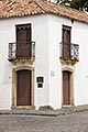 heritage stock photography | Uruguay, Colonia del Sacramento, Ornate balcony, street corner, Historic District, image id 8-803-4662