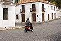 history stock photography | Uruguay, Colonia del Sacramento, Motorbike on cobbled street, Historic District, image id 8-803-4667