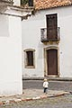 vertical stock photography | Uruguay, Colonia del Sacramento, Small boy on street corner, Historic District, image id 8-803-4673