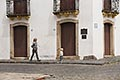 heritage stock photography | Uruguay, Colonia del Sacramento, Woman walking, cobbled street, Historic District, image id 8-803-4683