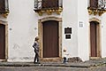 history stock photography | Uruguay, Colonia del Sacramento, Woman walking on sidewalk, Historic District, image id 8-803-4685