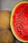 vertical stock photography | Food, Cut watermelon and canteloupe melons, image id 8-803-4717