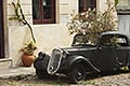 history stock photography | Uruguay, Colonia del Sacramento, Abandoned antique automobile on cobbled street, image id 8-803-4781