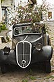 heritage stock photography | Uruguay, Colonia del Sacramento, Abandoned antique automobile on cobbled street, image id 8-803-4786