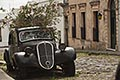 cobble stock photography | Uruguay, Colonia del Sacramento, Abandoned antique automobile on cobbled street, image id 8-803-4791