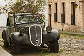 heritage stock photography | Uruguay, Colonia del Sacramento, Plants growing in antique black automobile, image id 8-803-4794