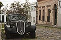 heritage stock photography | Uruguay, Colonia del Sacramento, Abandoned antique automobile on cobbled street, image id 8-803-4797