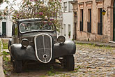 paving stone stock photography | Uruguay, Colonia del Sacramento, Plants growing in antique black automobile, image id 8-803-4800
