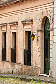 history stock photography | Uruguay, Colonia del Sacramento, Three windows and door with lamp, Historic District, image id 8-803-4803