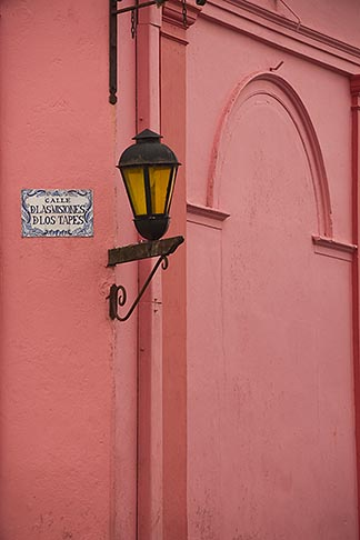 image 8-803-4881 Uruguay, Colonia del Sacramento, Single lamp and sign on orange wall, Historic District