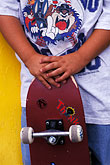 two people stock photography | Recreation, Skateboarders hands, image id 6-239-22