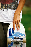 people stock photography | Recreation, Skateboarders hands, image id 6-239-27