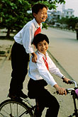 upright stock photography | Vietnam, Dien Bien Phu, Children on bicycle, image id S3-194-24