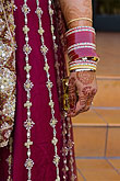vertical stock photography | Weddings, Indian wedding, Bride with bracelets and henna decorated hand, image id 6-455-7137