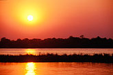 sunset on the zambezi river stock photography | Zimbabwe, Zambezi National Park, Sunset on the Zambezi River, image id 7-399-26