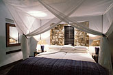 bed stock photography | Zimbabwe, Matetsi Lodge, room interior, image id 7-401-19