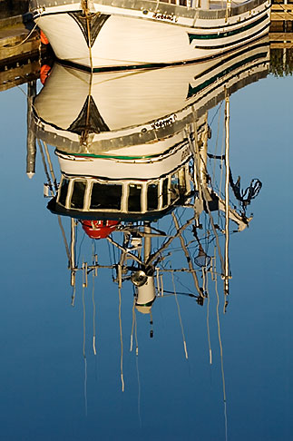 image 5-650-1165 Alaska, Kodiak, Fishing boat reflection