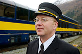 horizontal stock photography | Alaska, Anchorage, Alaska Railway conductor, image id 5-650-261