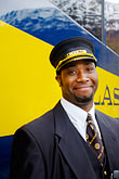 head covering stock photography | Alaska, Anchorage, Alaska Railway conductor, image id 5-650-276
