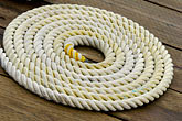 coiled ropes stock photography | Alaska, Prince WIlliam Sound, Rope coil on dock, image id 5-650-308
