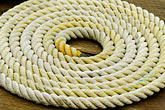 coiled ropes stock photography | Alaska, Prince WIlliam Sound, Rope coil on dock, image id 5-650-310