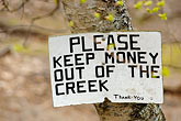 humour stock photography | Alaska, Anchorage, Please keep money out of the creek, image id 5-650-3194
