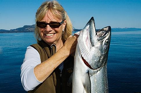 image 5-650-4151 Alaska, Kodiak, Fisherman and King Salmon