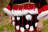 native american costume stock photography | Alaska, Anchorage, Feathered Alaskan native dress, image id 5-650-608