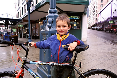 image 7-189-14 Alaska, Juneau, Young boy with bicycle