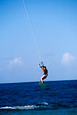 blue stock photography | Antigua, Jabberwock Beach, Kiteboarder jumping, image id 4-600-90