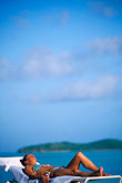 west stock photography | Antigua, Jolly Harbor, Woman sunbathing, image id 4-601-23