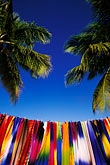 palms on the beach stock photography | Antigua, Jolly Harbor, Fabrics for sale on beach, image id 4-601-45