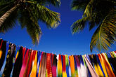 palms on the beach stock photography | Antigua, Jolly Harbor, Fabrics for sale on beach, image id 4-602-5